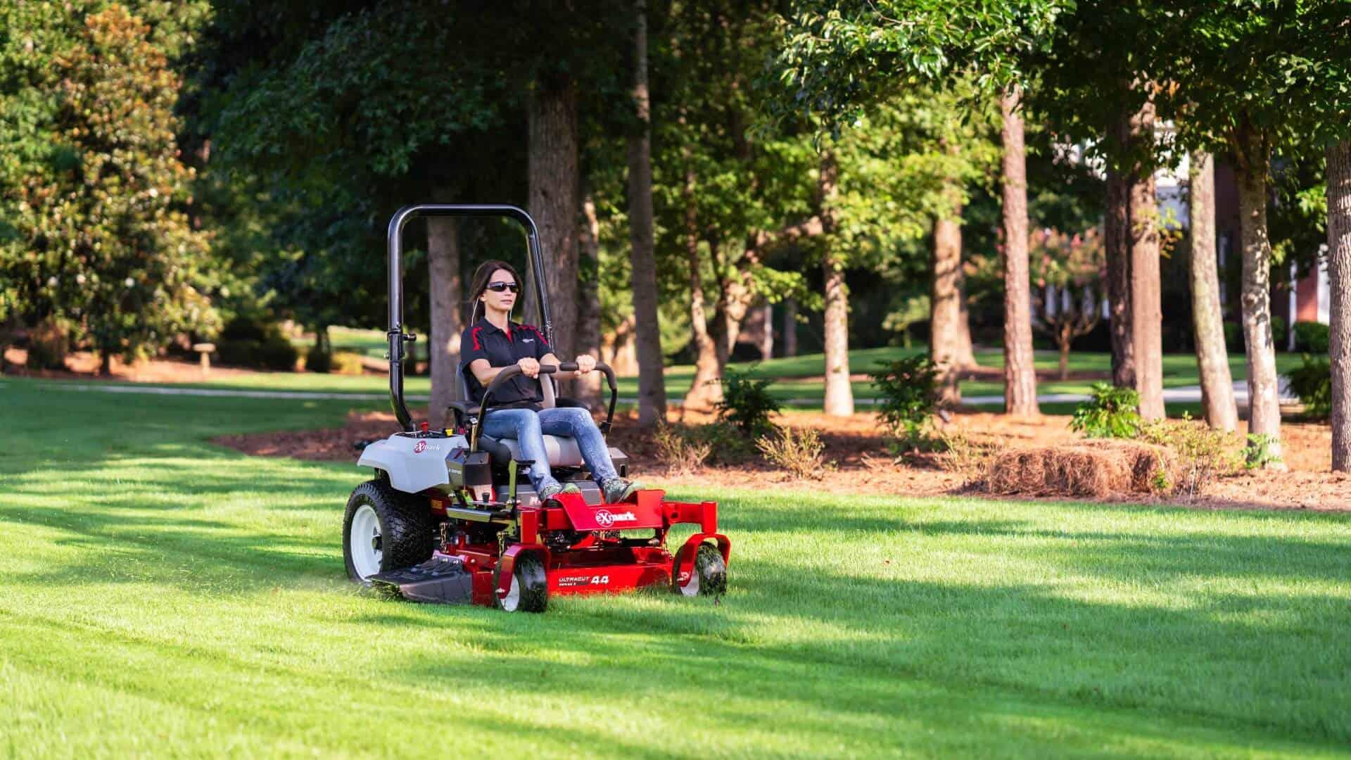 Mowing lawn around landscape