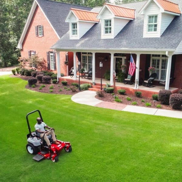 Man using Exmark mower to get a professional look