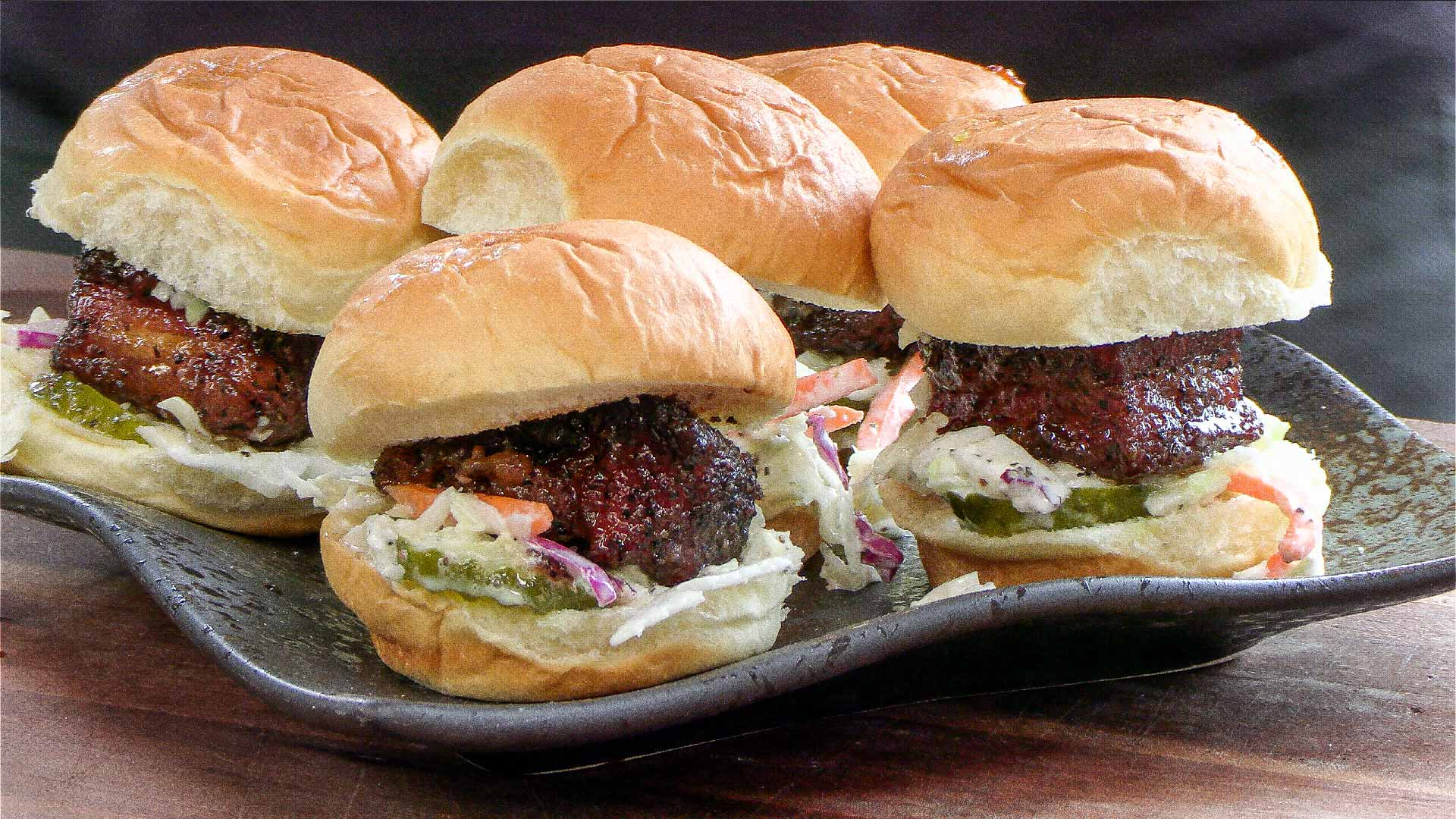 Sweet savory pork belly sliders with a touch of heat.