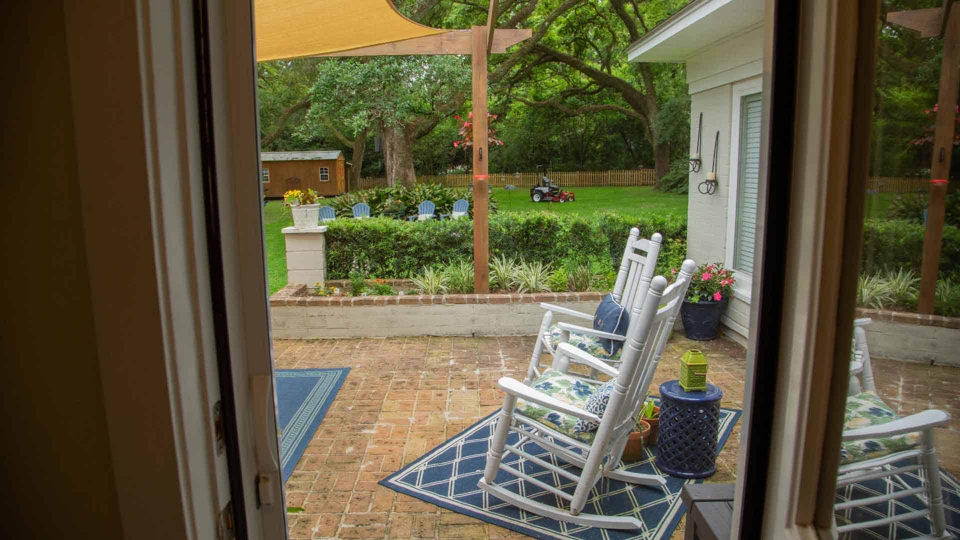 Unobstructed view of a outdoor space through a retractable screen door.